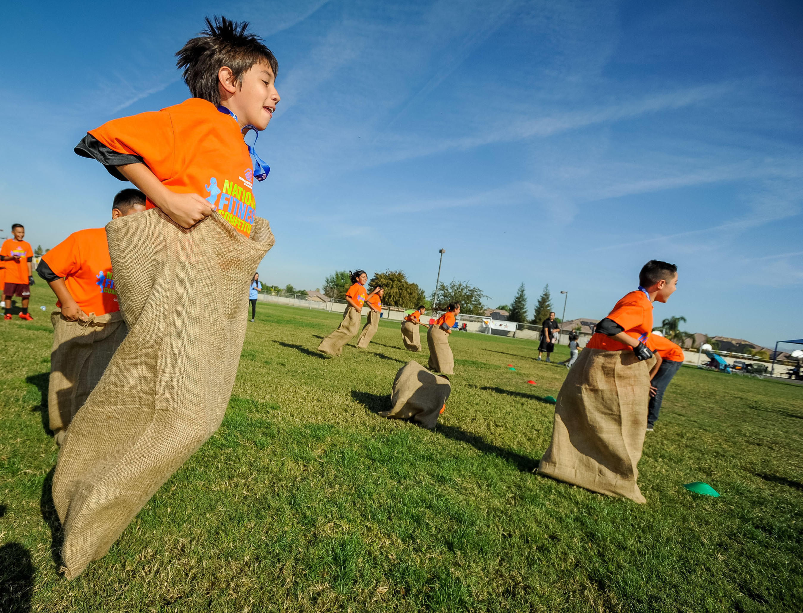 Youth from Boys & Girls Clubs of of Kern County participate in sack races during Boys & Girls Clubs of America and Nestle's National Fitness Competition in Bakersfield, California.