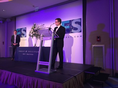 Andrew Blake, CTO, SpatialBuzz receiving the Frost & Sullivan 2015 European Technology Innovation Award for Cloud-based Customer Experience Management in Monaco. (PRNewsFoto/SpatialBuzz)