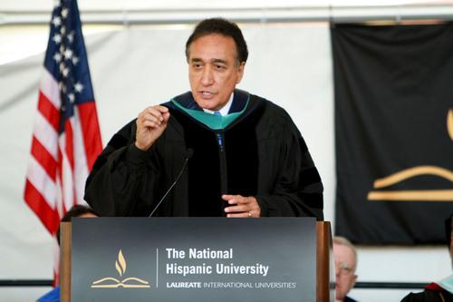 Henry Cisneros, former secretary of HUD, speaks at NHU's 28th commencement ceremony.  (PRNewsFoto/The National Hispanic University)
