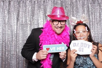 Wounded veterans and their daughters enjoy the photo booth at Daddy and daughter dance.