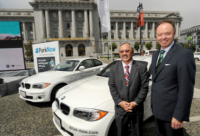 San Francisco Mayor Ed Lee and BMW Group board member Dr. Ian Robertson at a news conference announcing the launch of ParkNow and providing details of DriveNow on Monday, August 20, 2012 at Civic Center Plaza in San Francisco, CA. ParkNow, an innovative mobile parking solution and DriveNow, a unique premium car sharing service featuring all-electric BMW ActiveE vehicles, are available in San Francisco. (Noah Berger/newscast).  (PRNewsFoto/BMW North America, Noah Berger/newscast)