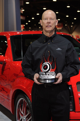Ken Czubay, Ford Vice President US Marketing Sales and Service with a 2012 SEMA Award for the Ford F-Series named Hottest Truck.  (PRNewsFoto/The SEMA Show)