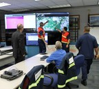 During the Parade of Ships, U.S. Coast Guard and Mariner personnel monitor CommandBridge security zones in the Incident Command Center. (PRNewsFoto/The Mariner Group)