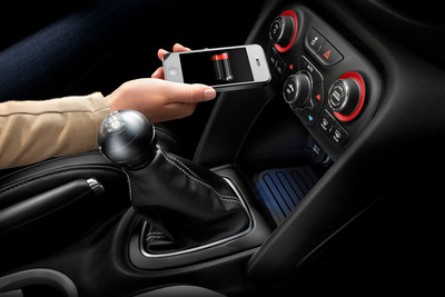 Chrysler Group LLC introduces industry-first in-vehicle wireless charging.  (PRNewsFoto/Chrysler Group LLC)