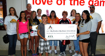 ACE Cash Express associates and family present Big Brothers Big Sisters with $10,300 donation.  (PRNewsFoto/ACE Cash Express)