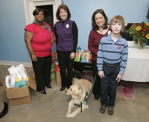 UCB Presents Donations to Canine Assistants in Honor of Epilepsy Awareness Month (Pictured from left: LaKeisha Parnell, Epilepsy Advocate; Sue Curro, UCB; Amy and Spencer Wyatt, Epilepsy Advocate) Photo Credit: John Amis/Associated Press. (PRNewsFoto/UCB)