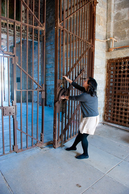 For the very first time, as part of Eastern State Penitentiary's new program, Hands-On History, visitors are handed the key and given directions on how to open the penitentiary's massive front gate.  (PRNewsFoto/Eastern State Penitentiary)