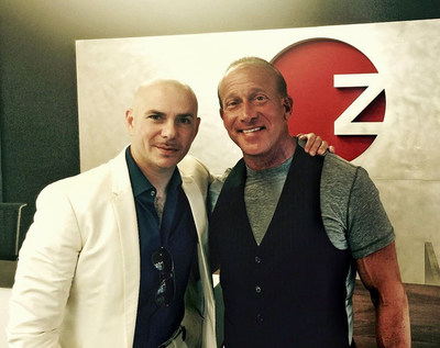 Multi-platnium artist Pitbull and business mogul Jordan Zimmerman pictured at Zimmerman headquarters in Fort Lauderdale, Florida.