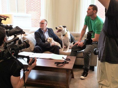 Kris Kiser; rescue dog Dottie; Lucky the TurfMutt, and Brandon McMillan of Lucky Dog discuss the new episode with the production team.
