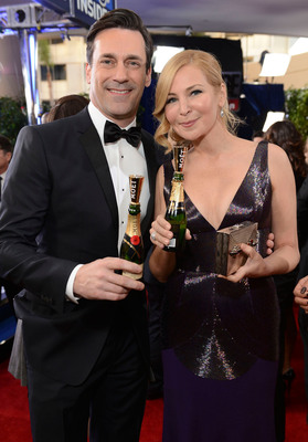 Jon Hamm and Jennifer Westfeldt raise a Moet mini for Moet & Chandons Toast for a Cause on the Red Carpet.  (PRNewsFoto/Moet & Chandon)