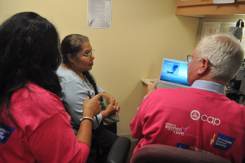 Isabel Gutierrez-Pineda of Buffalo, Minn., listens intently as Brad M. Linzie, MD, FCAP, a pathologist at ...