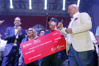 Travel Channel personality Andrew Zimmern, right, along with Red Robin CMO Jonathan Muhtar award a $10,000 check to Chefs Karen Sidell and David Daniels of MET Back Bay at the Amstel Light Burger Bash, during the Food Network & Cooking Channel South Beach Wine & Food Festival on Feb. 26, 2016 in Miami Beach, Fla. Sidell and Daniels also won the opportunity to have their award-winning burger featured as a limited-time-offer on Red Robin's Finest premium burger menu later this year. (Brian Blanco/AP Images for Red Robin)