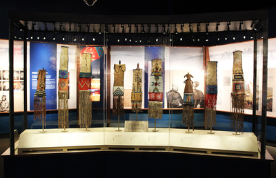 """The Great Smoke"" case features a series of pipes and pipe bags as part of The Smithsonian Institution's National Museum of the American Indian's latest exhibition, ""Nation to Nation: Treaties Between the United States and American Indian Nations."" Smoking played an important role at the Horse Creek Treaty gathering. The exhibition opens to the public at the National Museum of the American Indian on September 21, 2014. (PRNewsFoto/Smithsonian National Museum...)"