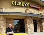 Seth Warren outside his first Dickey's Barbecue Pit in Castle Rock. Three lucky customers will get a chance to win free barbecue for a year. (PRNewsFoto/Dickey's Barbecue)