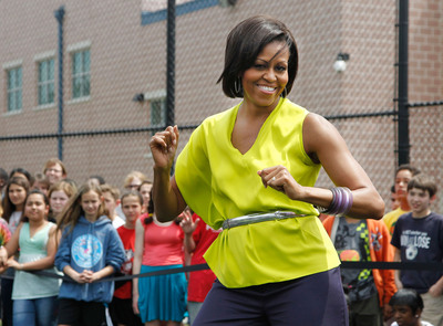 Michelle Obama dances alongside students at Alice Deal Middle School in Washington D.C. for the 2011 Let's Move! Flash Workout.  (PRNewsFoto/WAT-AAH!)