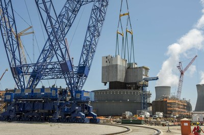 The 2.28 million-pound CA01 module is lifted into place at Plant Vogtle Unit 3 near Waynesboro, Georgia on Saturday, August 8. The module was lifted by a 560-foot tall heavy lift derrick, one of the largest cranes in the world.