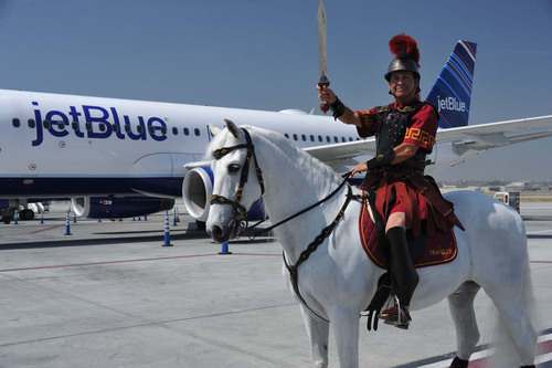 Trojan Mascot Traveler Posing in Front of a JetBlue plane at the JetBlue USC Trojans Partnership Launch.  ...