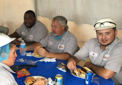 Martin's employees enjoy grilled food and snacks as part of the employee appreciation cookout.