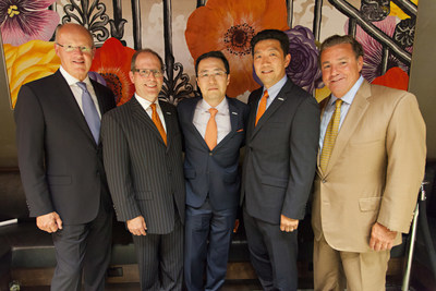 Mark Laport, CEO of Concord Hospitality, Mike Murphy, SVP of Upscale Brands at Choice Hotels, Philip and Robert Chun, We Care Trading LLC, and Steve Joyce, President and CEO of Choice Hotels at the grand opening of the Cambria hotel & suites New York-Chelsea