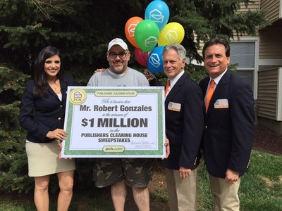 Robert Gonzales, winner of $1,000,000 posing for a picture with the Publishers Clearing House Prize Patrol!