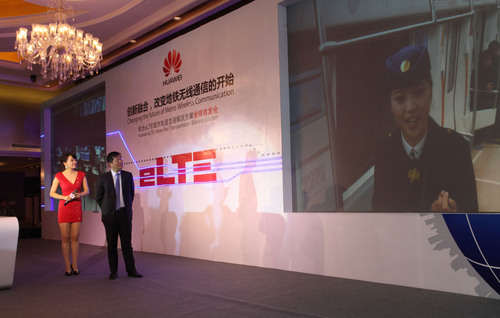 Onsite demonstration of a seamless ground to train video transmission between Mr. Patrick Zhang at the event ...