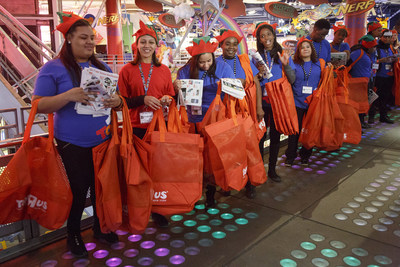 "Toys""R""Us team members line up to assist excited shoppers on Thanksgiving evening in 2014."