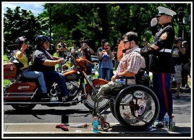 Tim Chambers - The Saluting Marine With Wounded Veteran Holding Salute at Rolling Thunder (PRNewsFoto/Anthony Castelli Attorney)