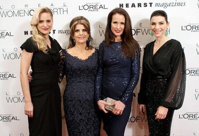 L'Oreal Paris spokespeople Aimee Mullins, Andie MacDowell and Julianna Margulies with L'Oreal Paris president Karen Fondu at the 2011 Women of Worth awards.  (PRNewsFoto/L'Oreal Paris)