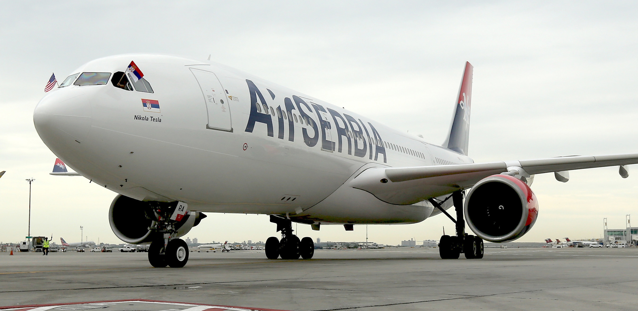 With Serbian and American flags flying high, Air Serbia's first flight JU 500 from Belgrade to New York taxis to a stop at JFK International Airport.