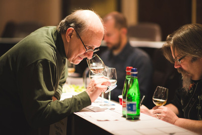 Ultimate Spirits Challenge Founder and Judging Chairman F. Paul Pacult (L) and Dave Wondrich (R) conferring at Ultimate Spirits Challenge 2014. Photo Credit: Daniel Krieger