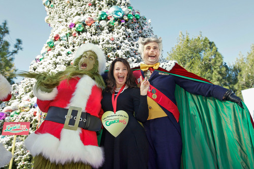 "The Grinch(TM) and Max the Dog heralded the arrival of Universal Studios Hollywood's(SM) festive ""Grinchmas(TM)"" holiday celebration with the presentation of the ""Who-Manitarian of the Year"" award to actor, producer, writer and women's health advocate Fran Drescher.  (PRNewsFoto/Universal Studios Hollywood)"