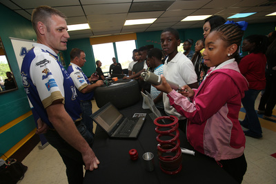 """In support of Aaron's Foundation's $1 million sponsorship of Boys & Girls Clubs of America's premier teen leadership program, Keystone, Michael Waltrip Racing shock specialist Jeremy Sharpley gave teenagers a hands-on demonstration during """"The Science of Speed"""" event at the Birmingham A.G. Gaston Boys & Girls Club on Thursday, May 1, 2014. The event was designed to give teenagers an exciting and educational look at how a science, technology, engineering and math (STEM) education can pave the way to a future in NASCAR. (PRNewsFoto/Boys & Girls Clubs of America)"""
