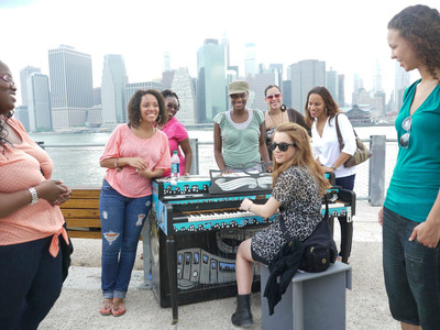 A Sing for Hope Piano in Brooklyn Bridge Park painted by local Brooklyn artist Adam Suerte. Photo by Adam Suerte.