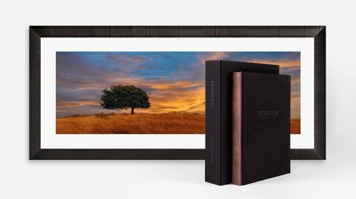 Peter Lik - Equation of Time - This epic new book represents over 30 years in award winning landscape photography. A virtual gallery in itself, this 106-pound, 528-page world-class compilation features hundreds of images from Peter's legendary portfolio, 20 of which span up to an impressive 40 inches across. Accompanying each Limited Edition is a corresponding signed and numbered, 1.5 meter framed image of Peter's latest masterwork, Blazing Skies.