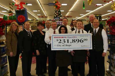 Pictured from left to right:  Tami Case, City of Hope Pediatric Dept; Matt Hebert, cancer survivor treated at City of Hope; Cheryl Kennick, City of Hope Food Industries Circle; Bruce Lewis, Stater Bros. District Manager; Dan Meyer, Stater Bros. Senior Vice President Retail Operations; Kathy Castillo, Stater Bros. Clerk (and #9 seller in chain); David Higginbotham, Stater Bros. Regional Vice President; Steven Walters, Stater Bros. Assistant Store Manager; Alan Royster, Stater Bros. Clerk (and #2 seller in chain); Jim Lee, Stater Bros. President & COO; and Marc Maloof, Stater Bros. Store Manager.  (PRNewsFoto/Stater Bros. Charities)