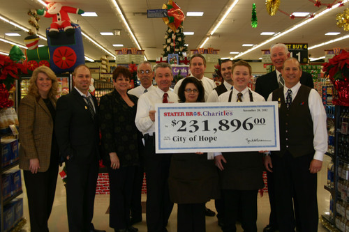 Pictured from left to right:  Tami Case, City of Hope Pediatric Dept; Matt Hebert, cancer survivor treated at City of Hope; Cheryl Kennick, City of Hope Food Industries Circle; Bruce Lewis, Stater Bros. District Manager; Dan Meyer, Stater Bros. Senior Vice President Retail Operations; Kathy Castillo, Stater Bros. Clerk (and #9 seller in chain); David Higginbotham, Stater Bros. Regional Vice President; Steven Walters, Stater Bros. Assistant Store Manager; Alan Royster, Stater Bros. Clerk (and #2 seller in chain); Jim Lee, Stater Bros. President  ...