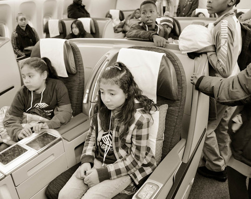 As part of a S.T.E.M. initiative, Qatar Airways hosts the Boys & Girls Club of Greater Washington at Dulles Airport, giving them an all-access tour of the airport and the airline's Boeing 777-300ER.  (PRNewsFoto/Qatar Airways)