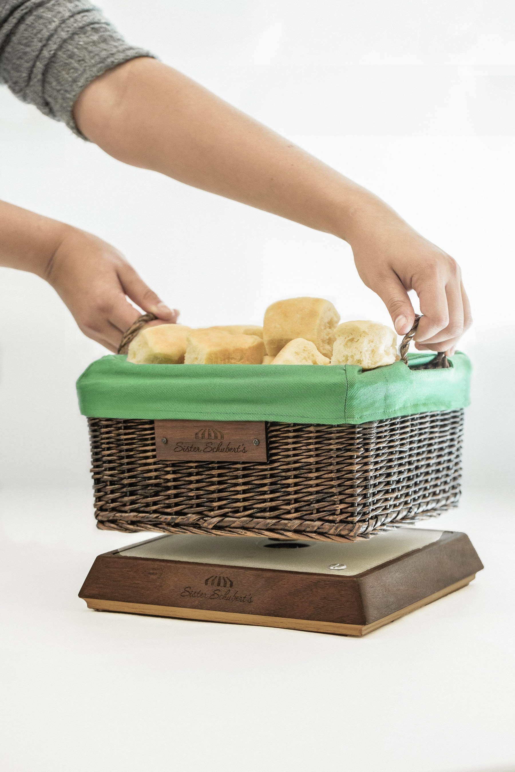 Sister Schubert's, the baked goods brand dedicated to encouraging family connections through warm family dinners, has developed the ultimate tool to help families disconnect from technology and reconnect with each other. The Basket of Warmth keeps dinner rolls warm, but only when the family's electronic devices are plugged into the base and tucked out of the way of dinner conversations.