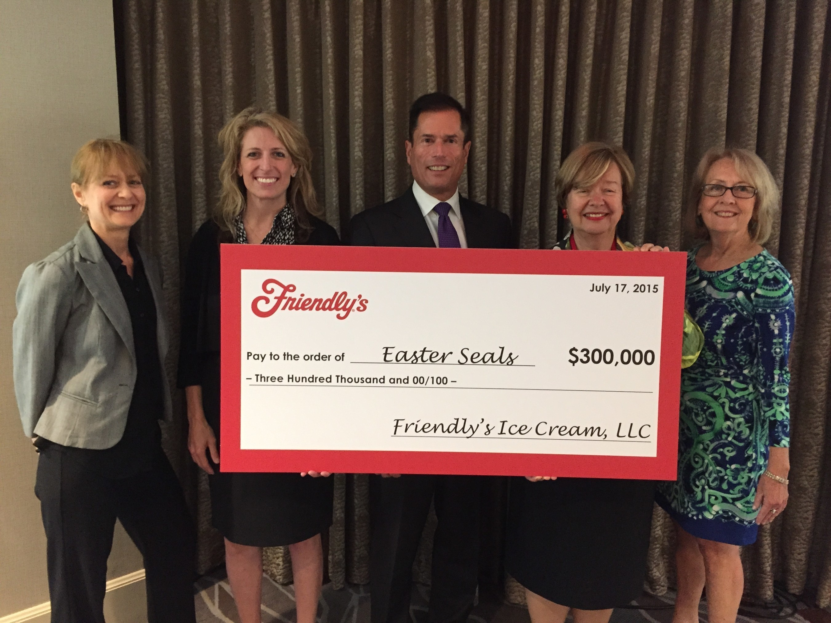 Easter Seals President & CEO, Randy Rutta and Easter Seals staff and board members pictured here receiving Friendly's generous 2015 Cones for Kids gift.