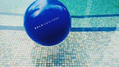 Bold New York beach balls make a splash at Life Time at Sky's zero-edge pools.