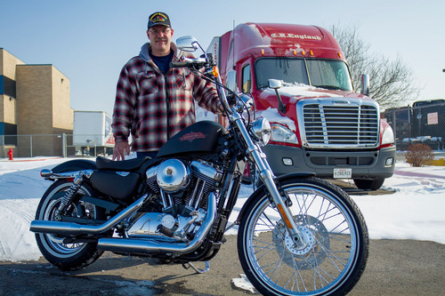 C.R. England, a Salt Lake City-based global transportation provider, has awarded a Harley-Davidson Sportster Seventy-Two to company driver Brent Sanger for showing improvement in miles per gallon average and average idle percentage for the fourth quarter 2012.  (PRNewsFoto/C.R. England)