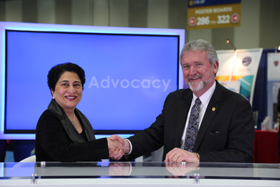Ritu Nayar, MD, president of the American Society of Cytopathology, and Gene N. Herbek, MD, FCAP, president of the College of American Pathologists, shake hands to commemorate the collaboration between the two organizations.  (PRNewsFoto/College of American Pathologists)