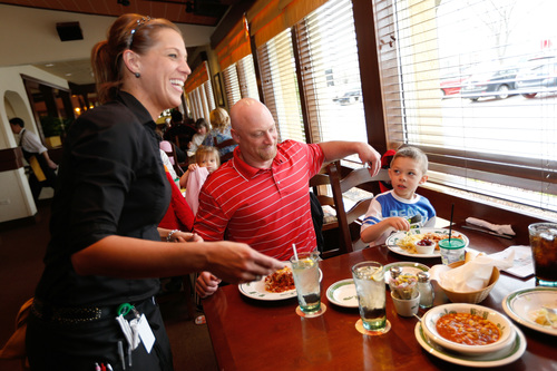 Olive Garden invites families to celebrate and enjoy a special meal together on Take Our Daughters and Sons to Work Day on Thursday, April 24, and is offering one free children's menu item (children under 12) for every adult entree purchased that day. Olive Garden has partnered with the Take Our Daughters and Sons to Work Foundation since 2012, and last year more than 7,000 Take Our Daughters and Sons to Work Day participants visited Olive Garden restaurants nationwide. (PRNewsFoto/Olive Garden)