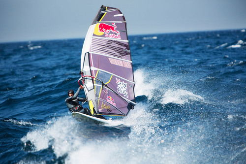 Red Bull Athlete Kai Lenny celebrates his 56 mile journey across Lake Michigan.  (PRNewsFoto/Red Bull)
