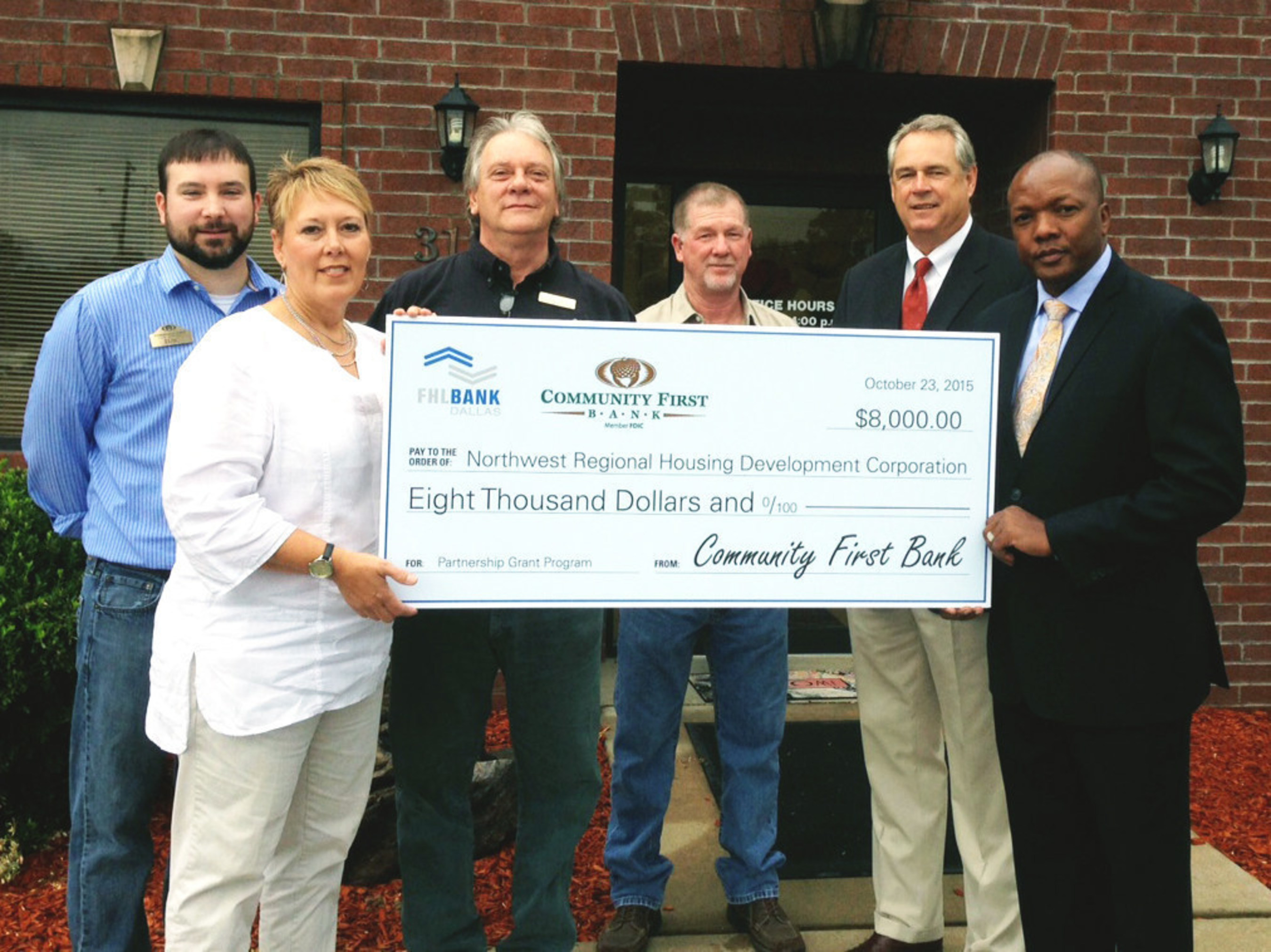 The Federal Home Loan Bank of Dallas and Community First Bank presented Northwest Regional Housing Development Corporation with an $8,000 PGP check last week. Pictured (from left): Eric Parker and Carolyn Arnold, Community First Bank; Troy Clark and Neal Gibson, Northwest Regional Housing Authority; Mike Lambert and Bruce Hatton, Federal Home Loan Bank of Dallas.