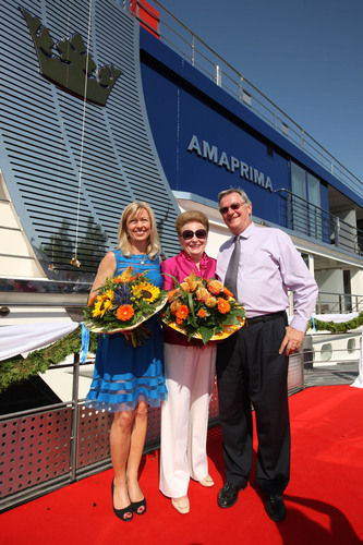 """(L to R) AmaWaterways Executive Vice President and Co-Owner Kristin Karst, honorary ship """"Godmother"""" and top travel industry executive Valerie Wilson, and AmaWaterways President and Co-Owner Rudi Schreiner at the christening of AmaWaterways' newest ship, AmaPrima, on Aug. 6 in Vilshofen, Germany. (PRNewsFoto/AmaWaterways) (PRNewsFoto/AMAWATERWAYS)"""