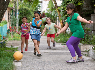 Children play with a new, virtually indestructible football provided by Chevrolet in partnership with the One World Futbol Project in Urbanizacion Jardines del Volcan, El Salvador. The collaboration will result in the donation of 1.5 million footballs by Chevrolet to youth in war-stricken zones, refugee camps, disaster areas, and other disadvantaged communities around the word. The automaker's pledge will be fulfilled through a global network of organizations dedicated to helping empower the next generation of footballers. Its support is part of a companywide global football initiative that includes sponsorship of Barclays Premier League giant, Manchester United team (Chevrolet News Photo).  (PRNewsFoto/General Motors)