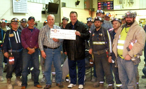 West Virginia University men's basketball head coach, Bob Huggins accepts a donation for the Norma Mae Huggins Cancer Research Endowment from employees of CONSOL Energy's Robinson Run mine during midnight shift change at the Camp Run portal in Mannington, W.Va. (PRNewsFoto/CONSOL Energy Inc.) (PRNewsFoto/CONSOL ENERGY INC.)