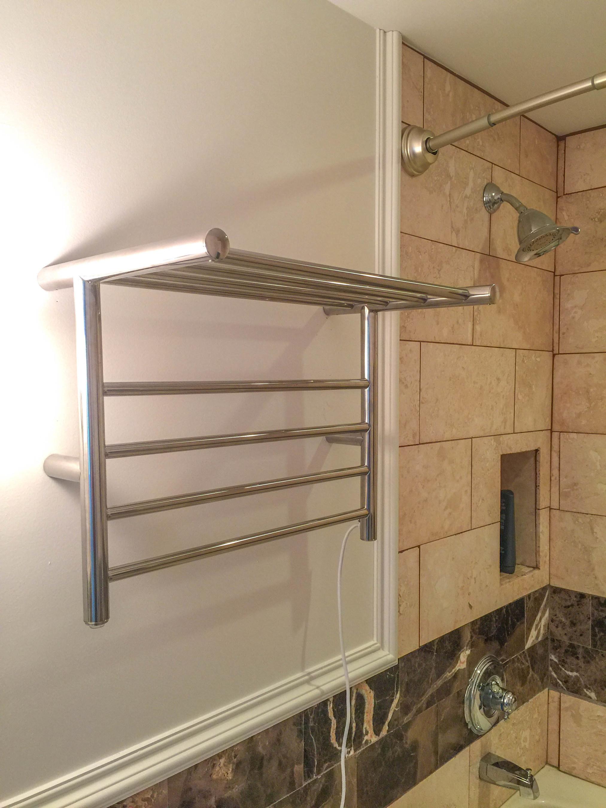Luxury heated towel racks set to warm things up in hotel - Heated towel racks for bathrooms ...