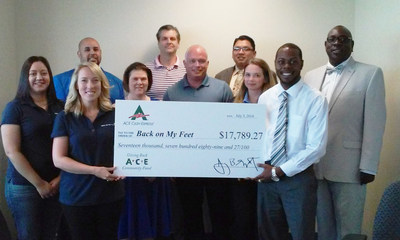 ACE employees make a $17,789 donation to Back on My Feet Dallas-Fort Worth staff. (PRNewsFoto/ACE Cash Express, Inc.)